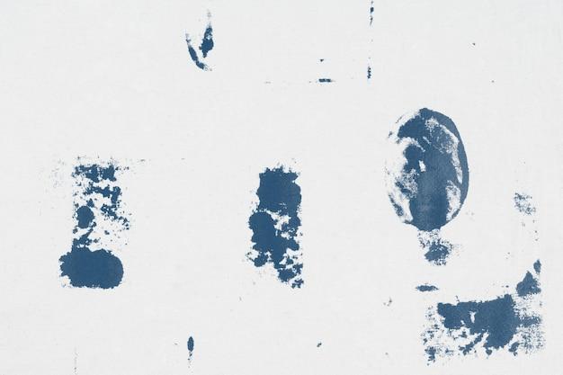 Motivo di sfondo con stampa a blocchi blu con macchie di tessuto