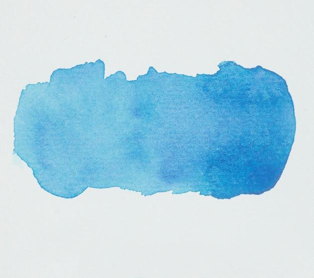 Macchia blu di vernici su carta bianca