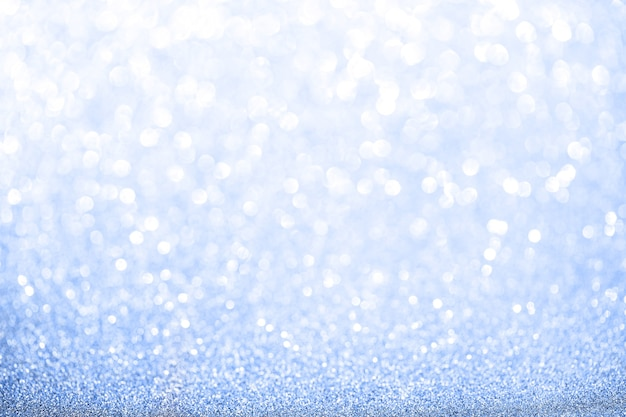 Blue blurred glitter background. sparkling and shiny texture for christmas and new year holiday or seasonal wallpaper decoration