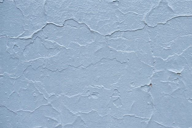 Blue board with cracks from paint. old wall background.