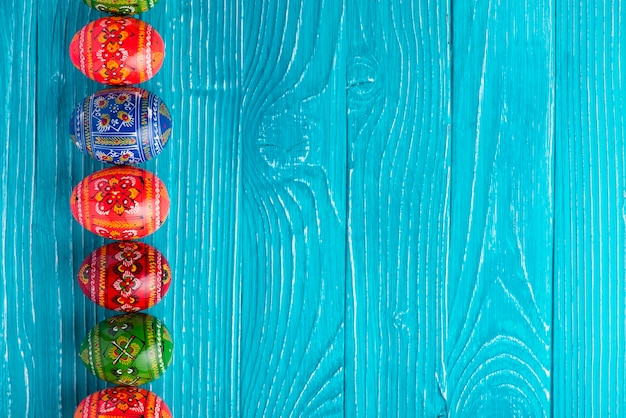 Blue boards with painted eggs for easter day