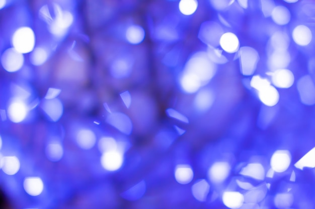 Blue bokeh defocused blurred lights. abstract background