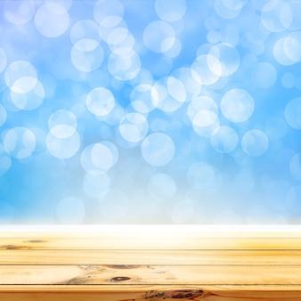 나무 테이블 제품 디스플레이와 블루 bokeh 조명 배경