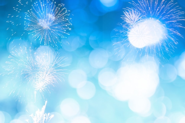 Blue bokeh with firework for new year or celebrate background