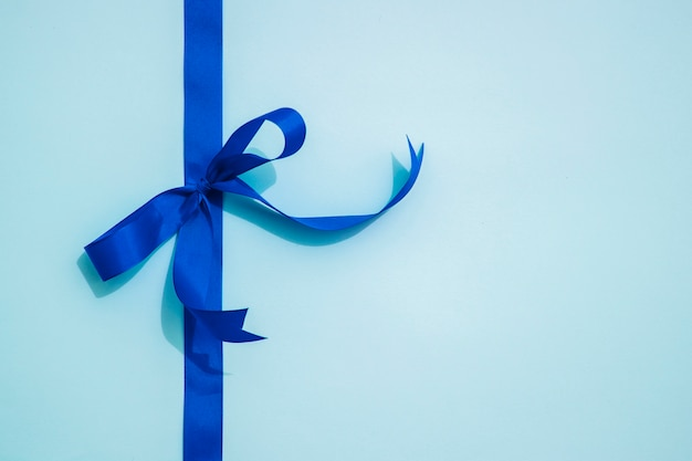 Blue bow ribbon and copy space