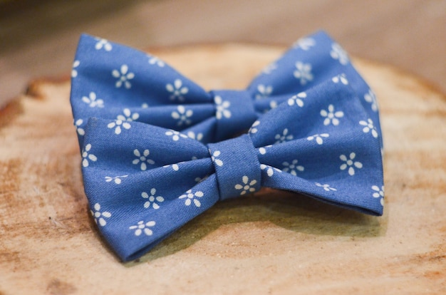 Blue bow tie isolated on wood background. classic blue color. color of the year 2020. trendy color