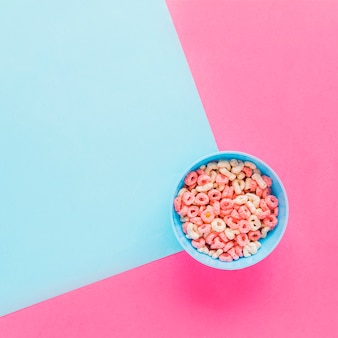 Blue bowl with cereal on table