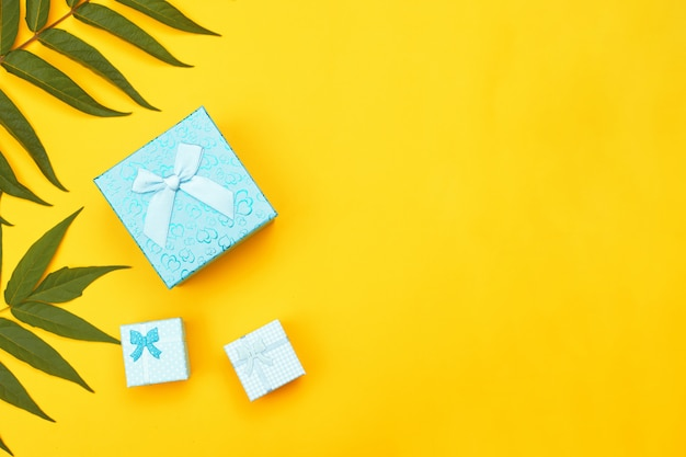 Blue boxes with gifts on a yellow background