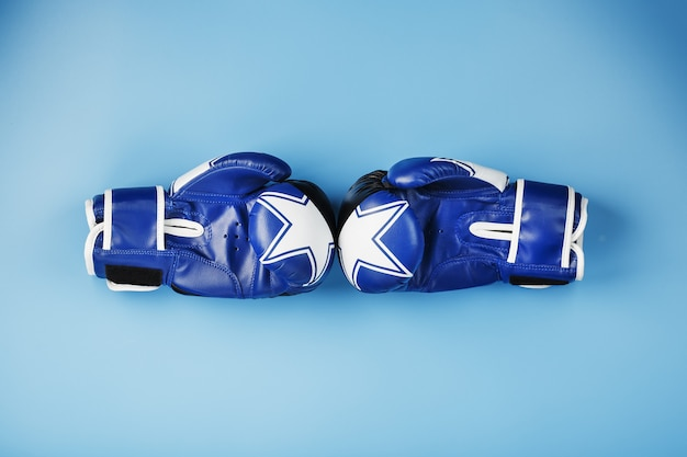 Blue boxing glove on a blue background