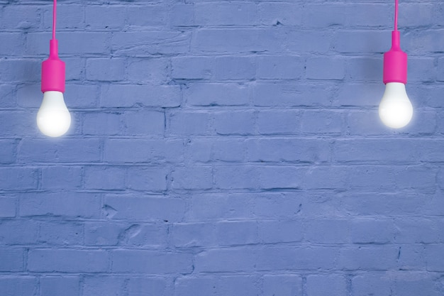 Blue brick wall with light bulbs creative copy space for your text or image