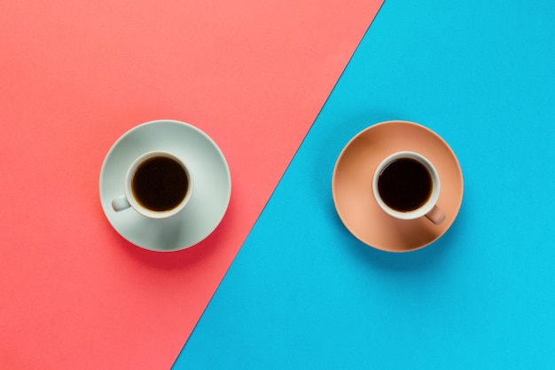 Blue and brown cup of coffee on a colorful