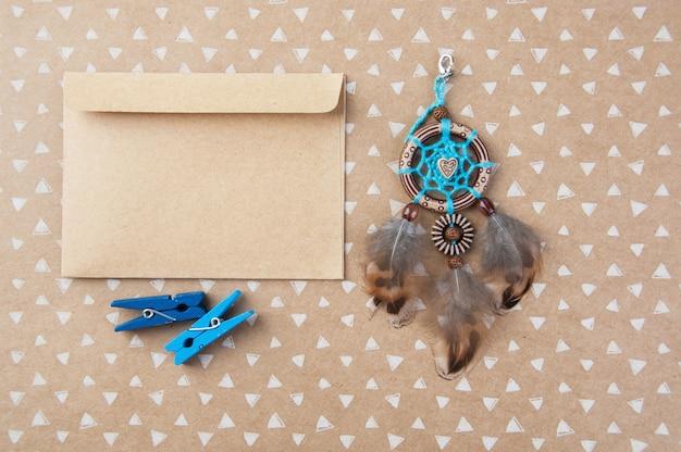 Blue brown dream catcher and kraft envelope