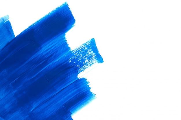 Blue brush strokes on white background