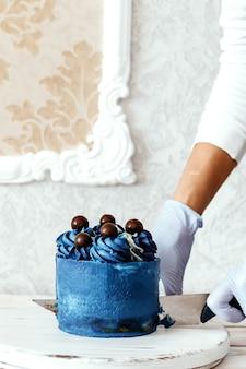 Blue cake, modern dessert, simple decoration.