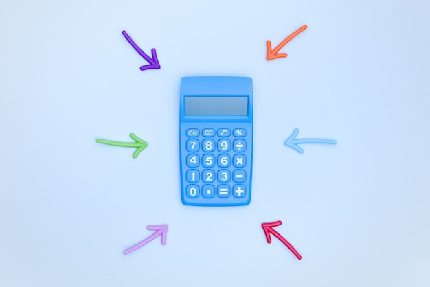 A blue calculator and multicolored arrows pointing to it on a blue background