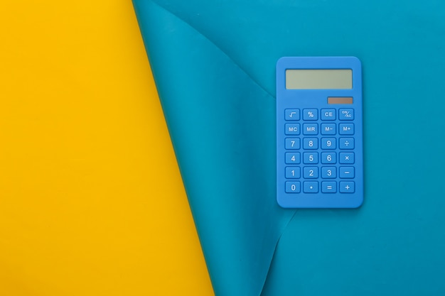 Blue calcylator on blue yellow. copy space