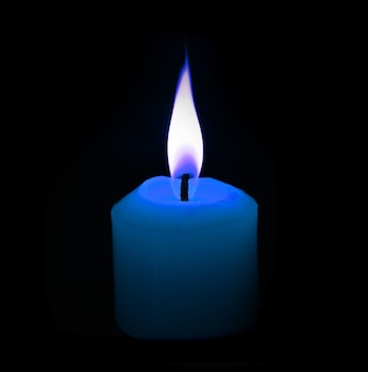 Blue candle on black background