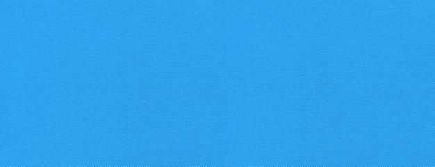 青いキャンバステクスチャ背景バナー。きれいな生地の壁紙