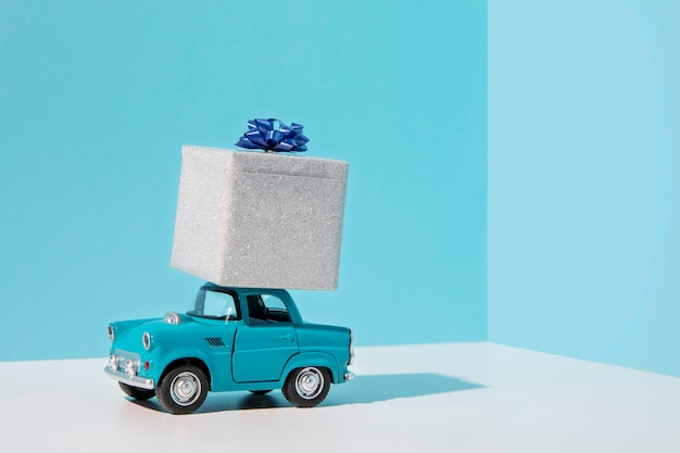 Blue car toy with present