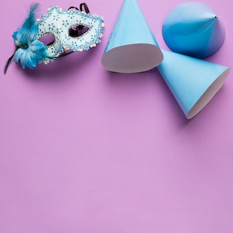 Blue carnival objects with copy space