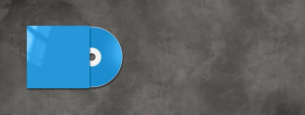 Blue cd dvd label and cover mockup template isolated on horizontal concrete