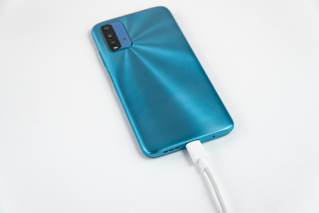 Blue cell phone connected to usb cable type c - charging