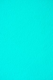 青いセメントまたはコンクリートの壁のテクスチャの背景。