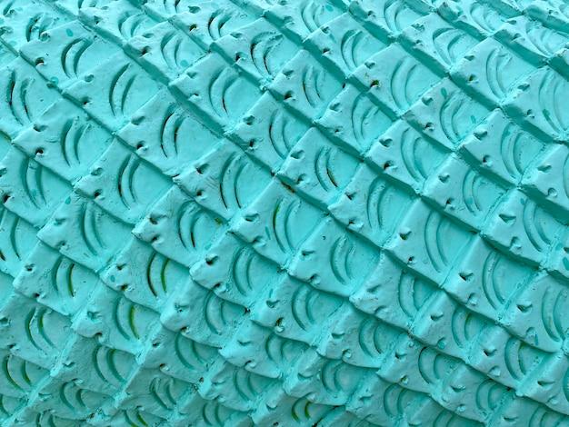 물고기 피부 곡선 패턴 질감 벽 배경에 파란색 시멘트 석고.