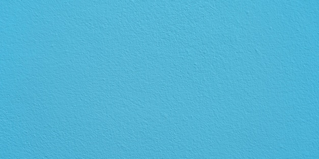 Blue cement wall texture for background and copy space for text. blue paper background.