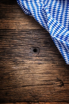 The blue checkered tablecloth  typical of the munich beer festival in the german oktoberfest