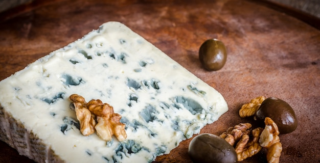 Blue cheese with walnuts closeup