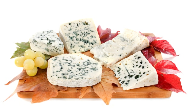 Blue cheeses with leaves on white
