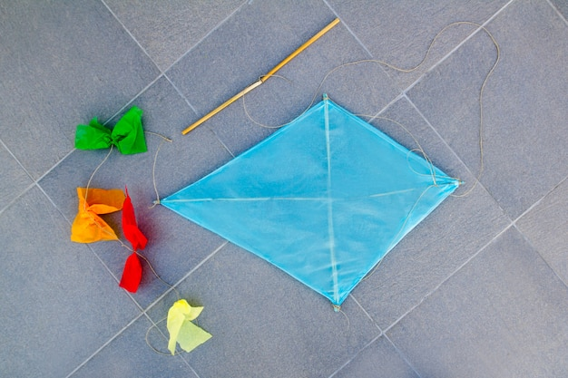 Blue children kite traditional diamond shape on floor