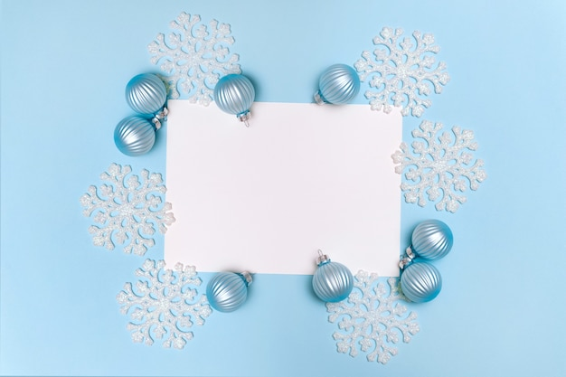 Blue christmas background with snowflakes decoration balls and empty blank for text flat lay copy space