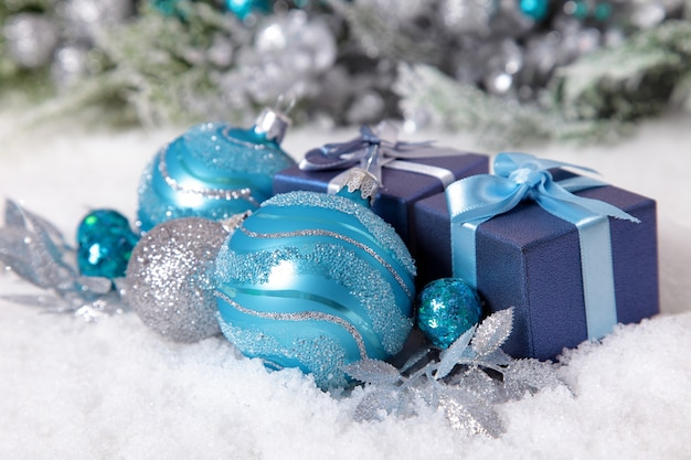 Blue christmas balls with a gift
