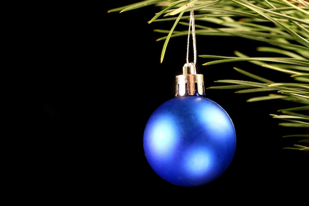 Blue christmas decoration ball in the dark