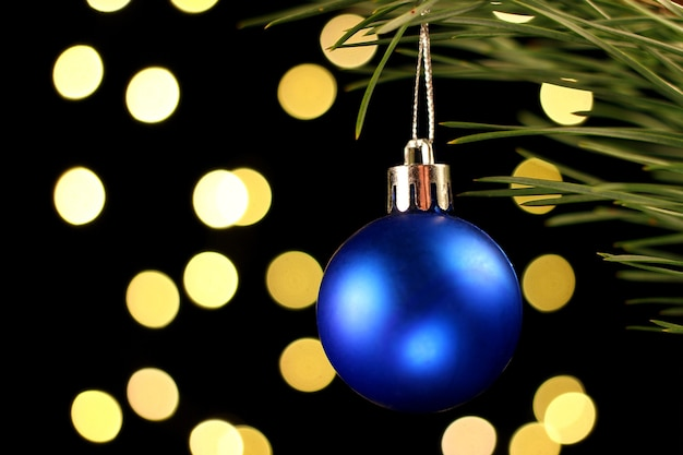 Blue christmas decoration is a ball in the dark