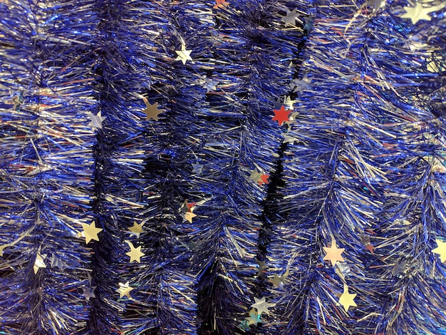 Blue christmas tinsel. multi-colored decorations for the celebration of the new year. texture.