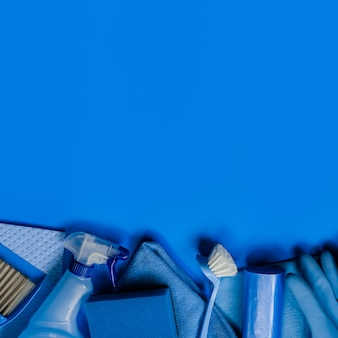 Blue cleaning kit for housekeeping. top view. copyspace.
