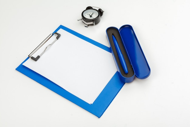 Blue clipboard  on office table, top view, flat lay