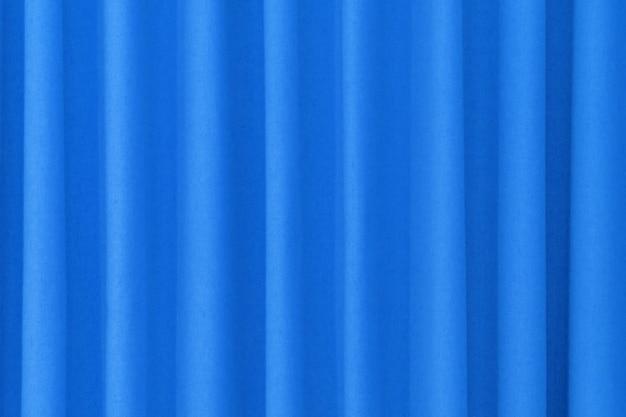 青いクローズアップカーテン背景極端なクローズアップ。