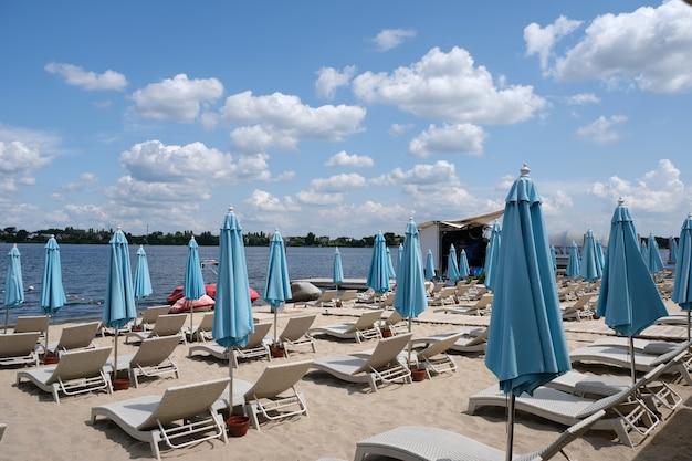 Blue closed stationary beach umbrellas