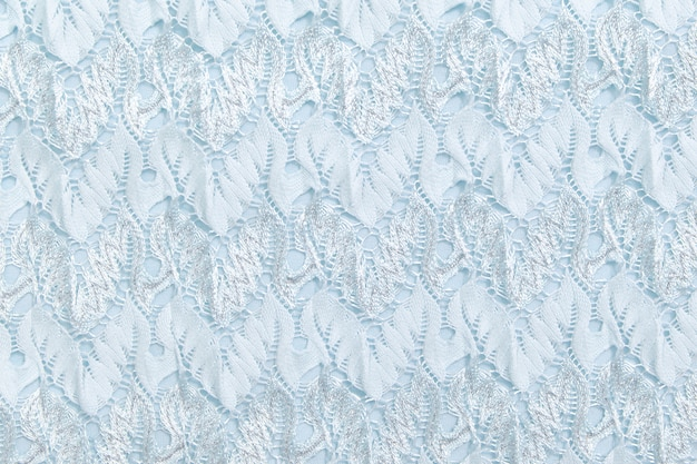 Blue cloth with embossed pattern, close-up. texture background