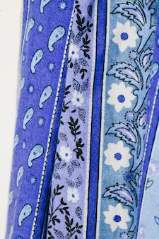 Blue cloth with flowers close-up