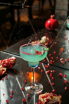 Blue cocktail with pomegranate and syrup