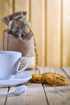 Blue coffee cup with cookies and bag