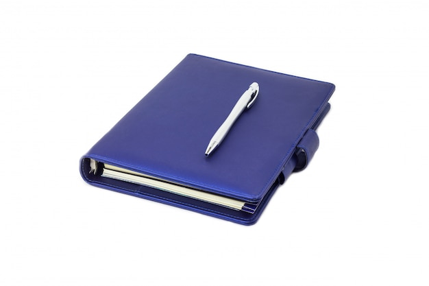 Blue collar diary and pen placed on cover and white