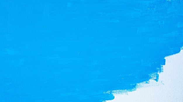 Blue color abstract paint with a brush and textures of water color oil colour drawing lines on white canvas background