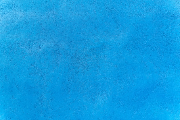 Blue color cement wall background for texture design
