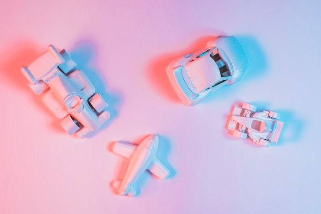 Blue color light on transport vehicle toys over pink background